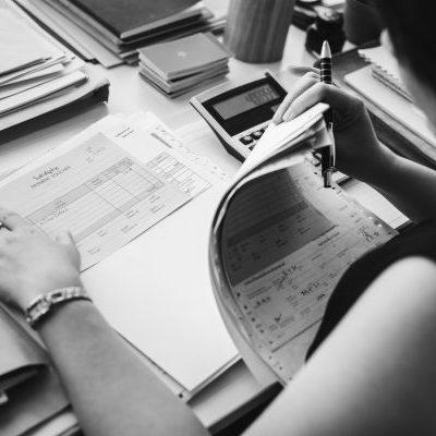 Asian woman working through paperwork Rawpixel